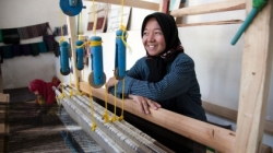 Woman at a silk weaving workshop. Photo credit: World Bank