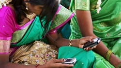Womem with mobile phones